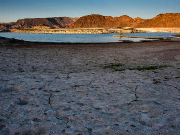 Cracked ground along the shore of Lake Mead is seen in Boulder City, Nevada, U.S., on Wednesday, June 3, 2015. The Southern Nevada Water Authority is building a three-mile (five-kilometer), $817 million tunnel under Lake Mead to retain access to its Colorado River supply as the reservoir declines to 40 percent of capacity. Photographer: David Paul Morris/Bloomberg