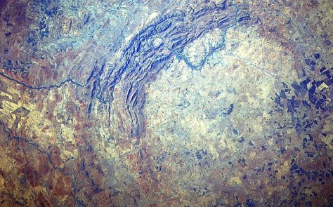 Vredefort in South Africa 100 miles diameter. It is the oldest crater made by either a meteorite or a comet and it is reportedly the site of the largest energy release in the world's history.